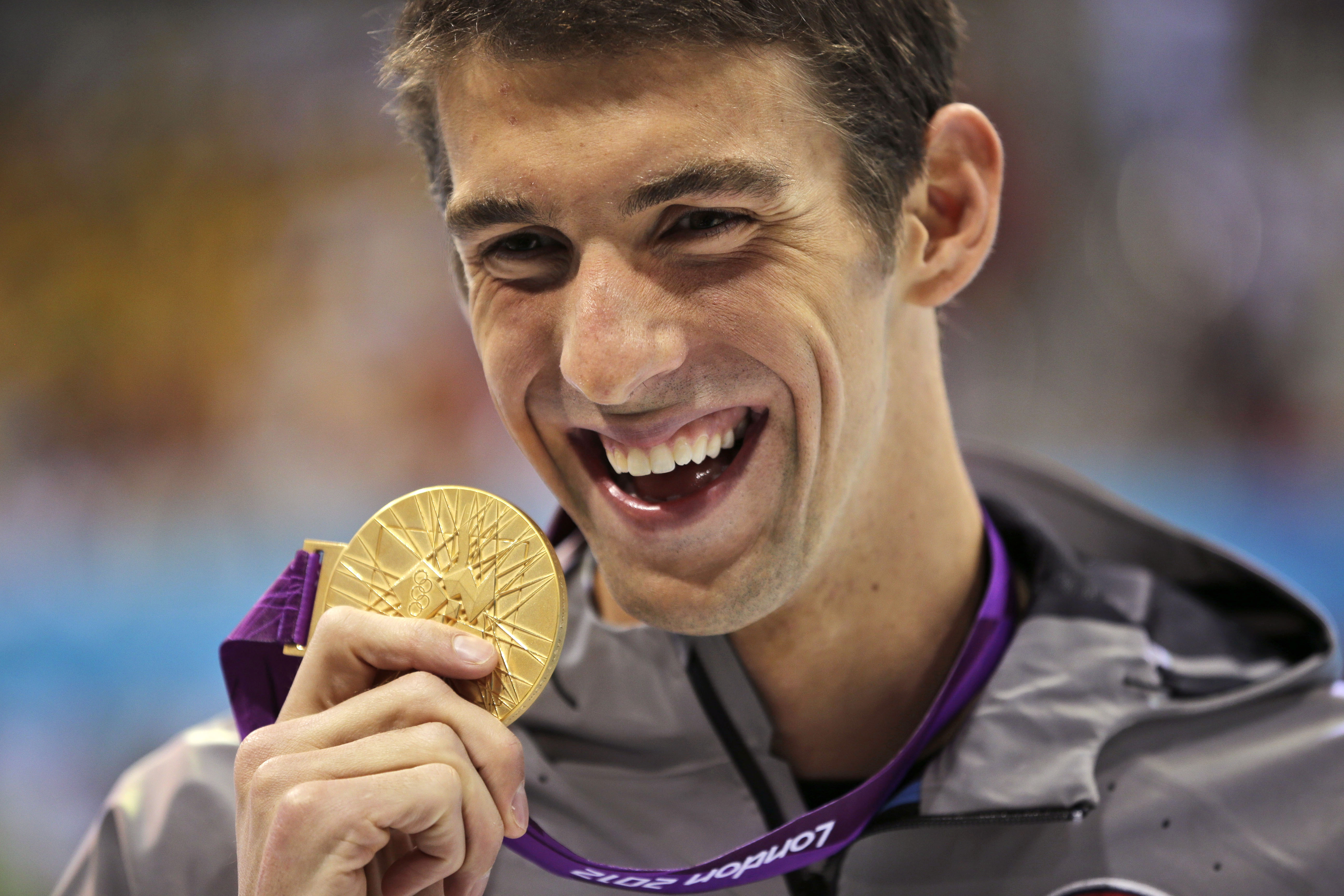 Sports Illustrated presents Michael Phelps with 'Greatest Olympian of All-Time' award